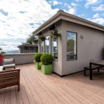 Private roof top deck with views of the Puget Sound, Olympic Mountains and the city.